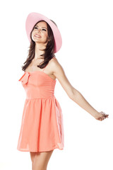 happy girl with a hat in a short dress