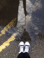 powerlines reflected in puddle