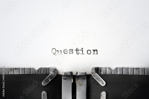 """Question"" written on an old typewriter"