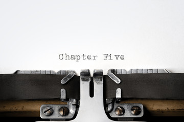 """Chapter Five"" written on an old typewriter"