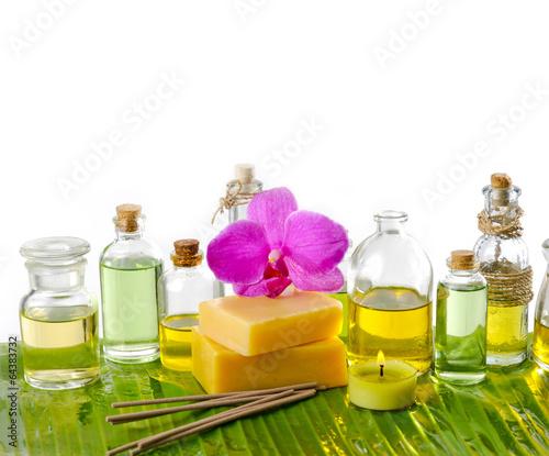 Poster Spa spa supplies with frangipani,oil,yellow candle on banana leaf