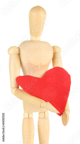 Wooden mannequin holding big red heart isolated on white