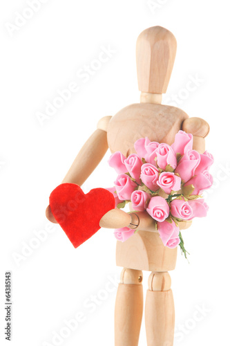 Wooden mannequin holding red heard and bouquet isolated on