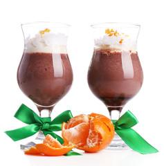 Tasty dessert with chocolate, cream and orange sauce, isolated
