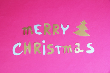 Merry Christmas lettering on pink background