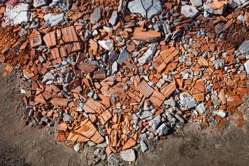 Pieces of beaten bricks and concrete blocks