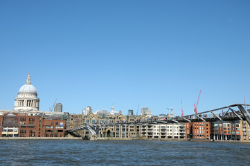 London skyline across River Thames at Millennium Bridge