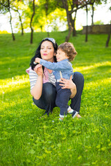 Mom and little boy having fun  in park