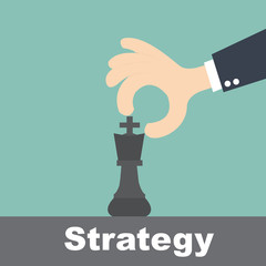 strategy concept - hand holding chess