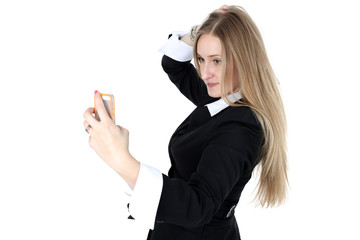 woman in business outfit take a self portrait with her  phone is