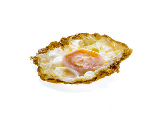 Thai styel deep fried eggs on a white background