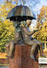 Children under an umbrella - Fountain in the Tallinn
