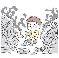 ゴミの中でゲームをする男の子