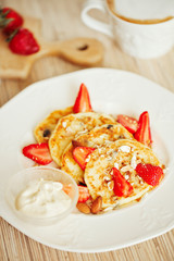 cheese pancakes with fruit, ripe strawberry, food close up