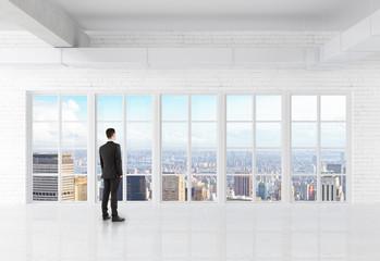 businessman looking at window