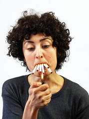 Woman lights up 5 cigarettes