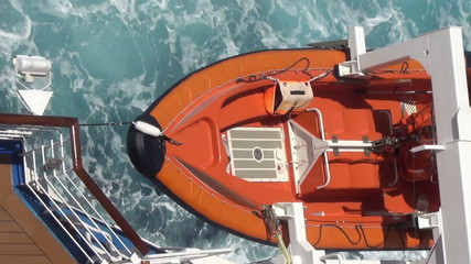 Lifeboat suspended over water