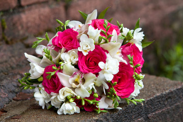 Bouquet of flowers of white and red colors of orchids and roses