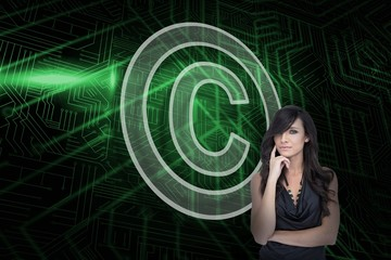 Composite image of copyright symbol and sexy brunette