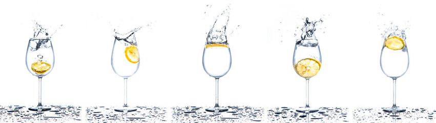 Lemon splashing into glasses of water on white background