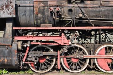 Steam train at a railroad graveyard
