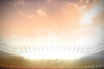 Large football stadium under cloudy blue sky