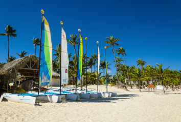 Few sail boats, catamarans, on tropical beach