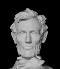Bust of Abraham Lincoln isolated on black background