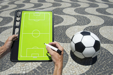 Hands Writing on Football Tactics Board Rio Beach Brazil