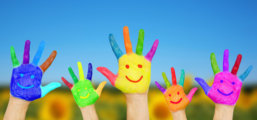 Smiling hands on summer background