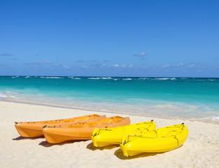 Colorful kayaks on sandy exotic beach