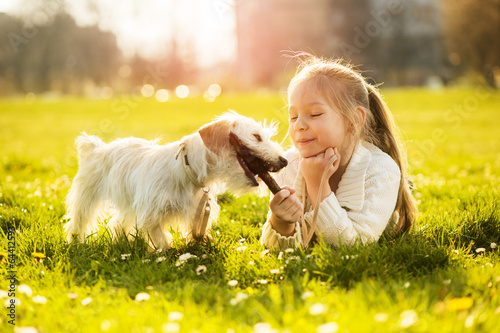 Little girl with her puppy dog - 64412593