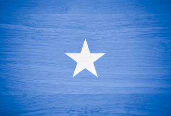 Somalia flag on wood texture