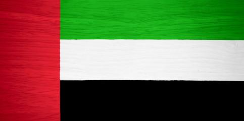 United Arab Emirates flag on wood texture