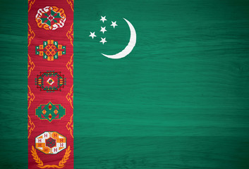Turkmenistan flag on wood texture