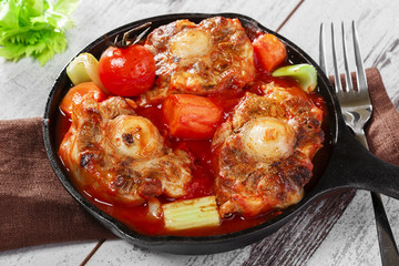 fried oxtail in red sauce with vegetables