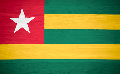Togo flag on wood texture