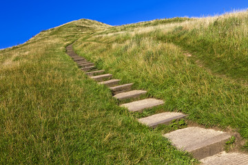 Blue sky and the green hill from Glastonbury Tor, UK