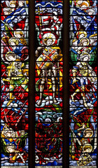 Stained glass with Saint Michael and Angels fighting the dragon
