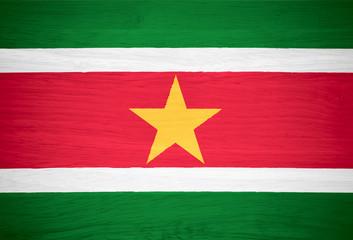 Suriname flag on wood texture