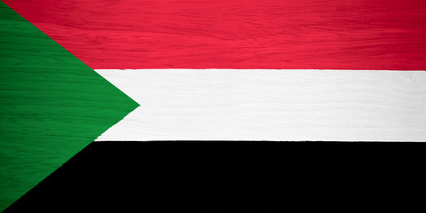 Sudan flag on wood texture