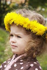 Little girl with dandelion wreath