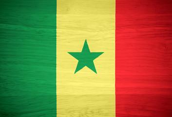 Senegal flag on wood texture
