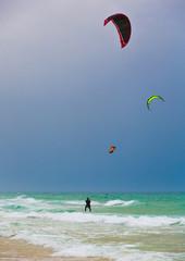 surfers parachutes