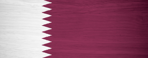 Qatar flag on wood texture