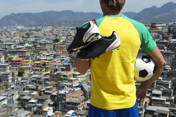 Brazilian Football Player in Kit Holding Soccer Ball Favela