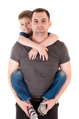 young father with his son on back isolated on white