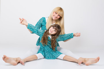 Mother and daughter in matching outfit having fun