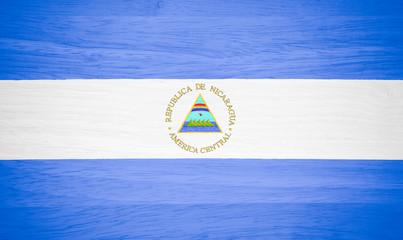 Nicaragua flag on wood texture