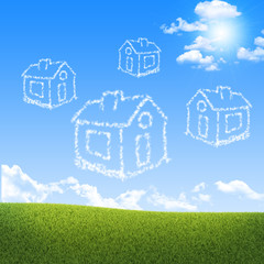 Houses of clouds in the sky over green grass